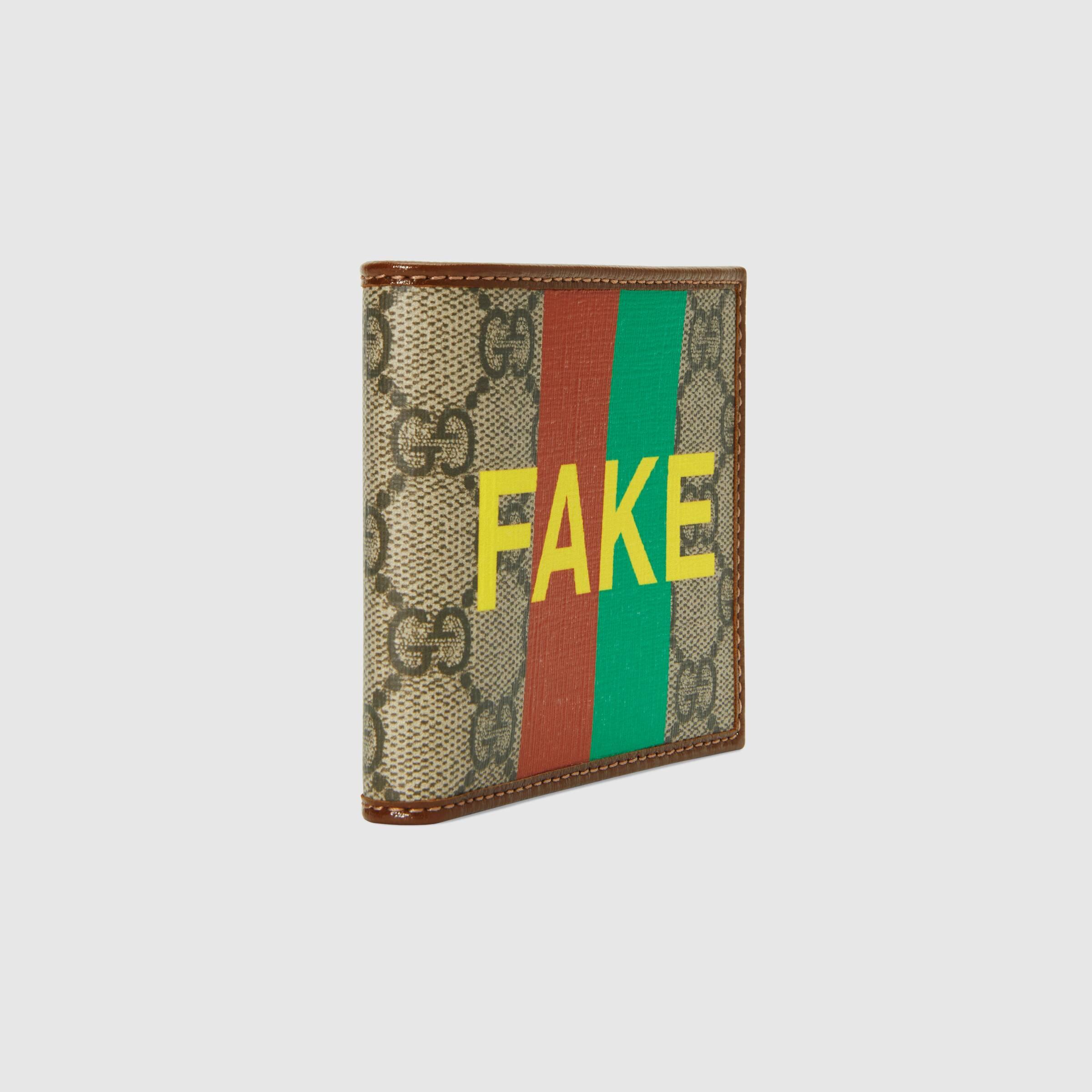 유럽직배송 구찌 GUCCI Gucci 'Fake/Not' print billfold wallet 6361662GCAG8280