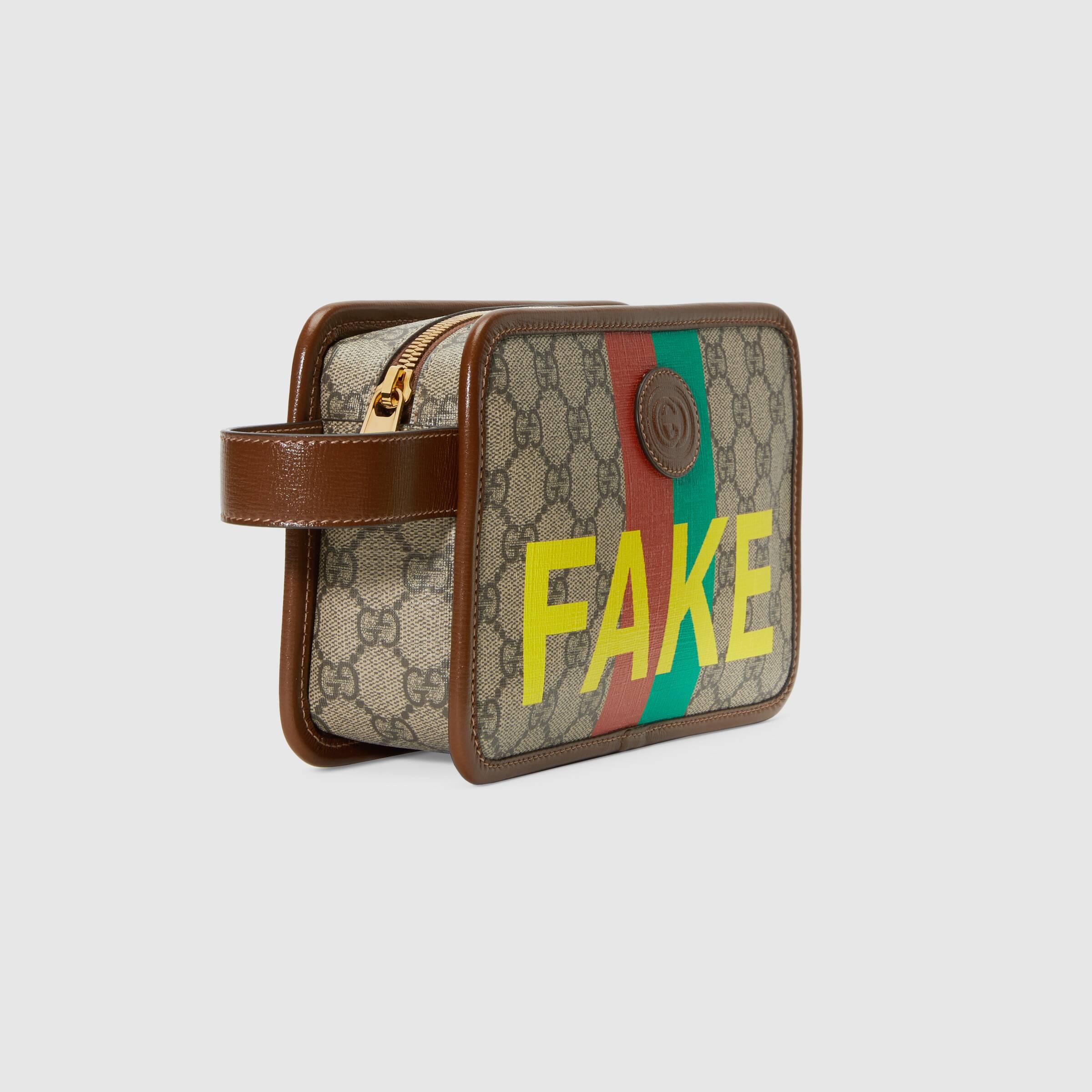 유럽직배송 구찌 GUCCI Gucci 'Fake/Not' print cosmetic case 6362432GCAG8280